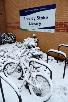 Bike in the snow outside Bradley Stoke Library.