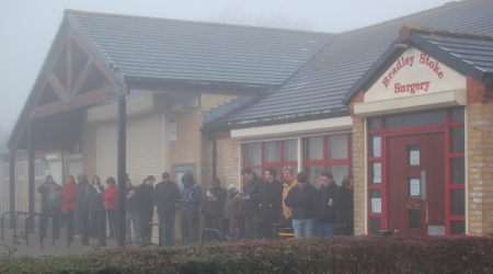 Patients queue outside Bradley Stoke Surgery.