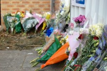 Floral tributes outside the property