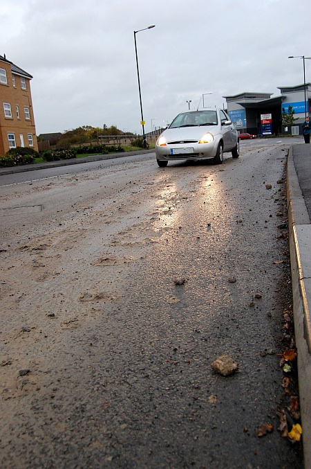 Mud on the road into the Willow Brook Centre, Bradley Stoke