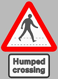 Humped crossing warning sign