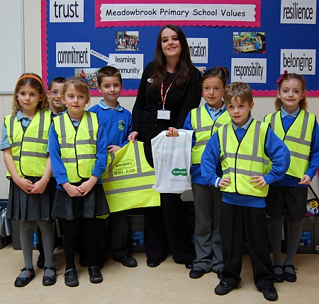 Specsavers present hi-vis vests to Meadowbrook Primary School in Bradley Stoke