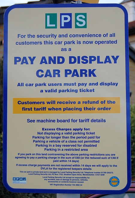 Pay and display sign in the car park of the Three Brooks pub