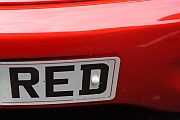 Registration plate on a red car. Photo by rbrwr on Flickr [licence: cc by-sa 2.0]