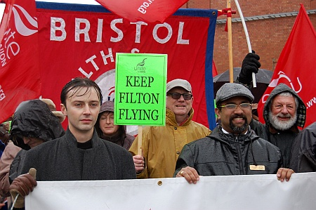 Bradley Stoke Town Councillor Tom Aditya (right) heads the march