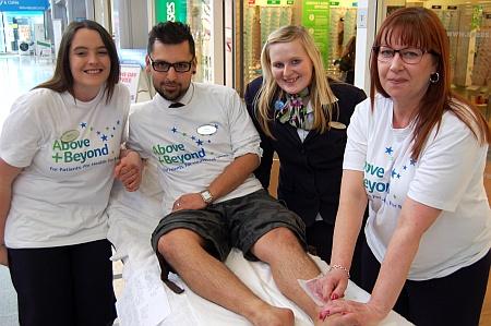Bradley Stoke Specsavers charity leg-waxing
