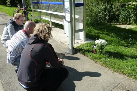 Friends pay their respects at the scene of the accident.