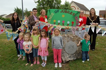 Plaque unveiled to mark dedication of Jubilee Green as a QEII Field in trust.