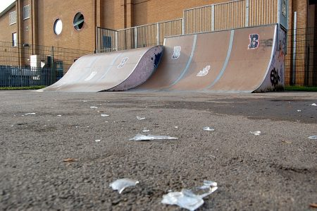 Broken glass litters the surface of Bradley Stoke Skate Park on a Saturday morning.