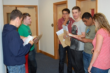 BSCS A-level students open their envelopes and compare results.