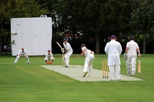 Cricket match in progress on an artificial wicket at Baileys Court, Bradley Stoke.