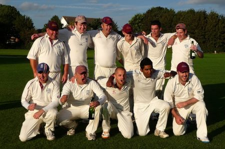 Bradley Stoke Cricket Club 1st XI players celebrate winning promotion.