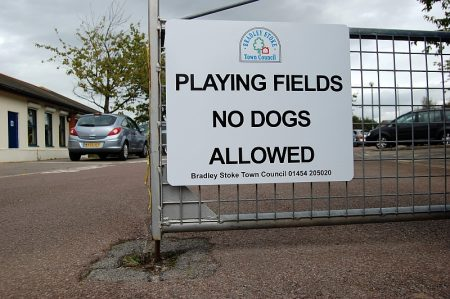 "Sign at Baileys Court Activity Centre: ""Playing fields - no dogs allowed""."