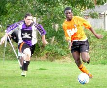 Shad Esimeng (right) on the ball for Bradley Stoke Town FC.