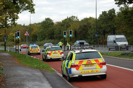 Police officers investigate the scene of an accident on Bradley Stoke Way.