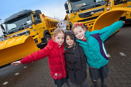 Pupils from Baileys Court Primary School with council gritting vehicles.