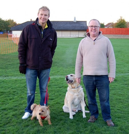 Dog walkers Kevin Wedlock (with Rossi) and Tom Adkins (with Charlie)