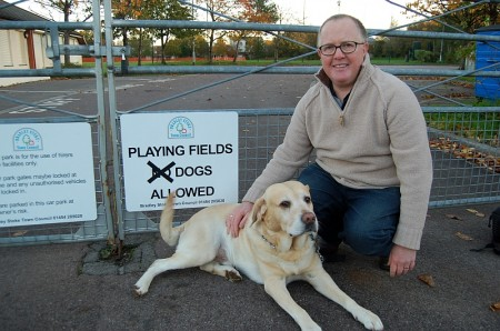 Tom Adkins and Charlie the labrador celebrate the Town Council's decision.