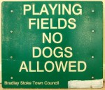 "Old ""no dogs allowed"" sign."