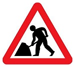 Roadworks warning sign.