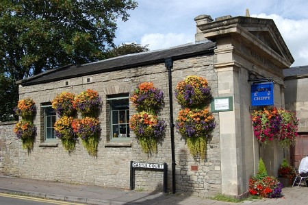Floral display outside Parky's Chippy in Thornbury.