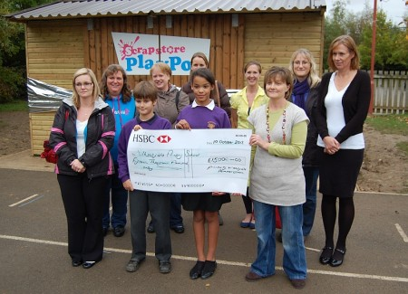 Members of the school's Friends Group hand over a cheque for £15,000.