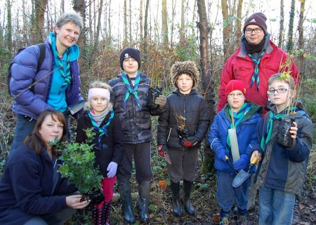 Beavers help plant a hedgerow in the Three Brooks Local Nature Reserve.