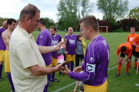 BSTFC Chairman Ian Drew congratulates the All Stars' captain.