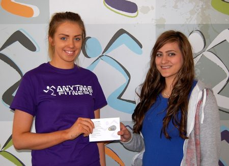 Anytime Fitness competition winner Leanne Robinson receives her prize.