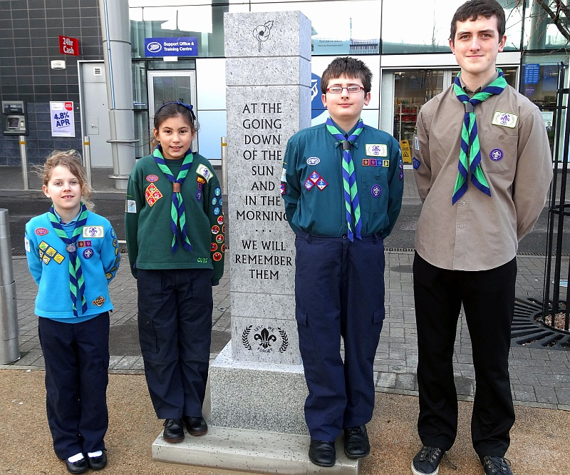 Scout group members beside the newly-installed war memorial in the town square.