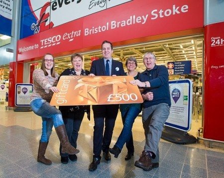 Shoppers collect £500 prizes at Tesco Extra, Bradley Stoke.