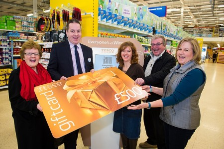 Fab five pick up their £500 Tesco gift cards in store.