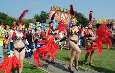 Bradley Stoke Carnival dancers and funfair on Jubilee Green.