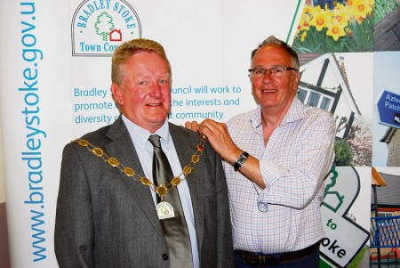Cllr John Ashe receives the chain of office from the outgoing Mayor.