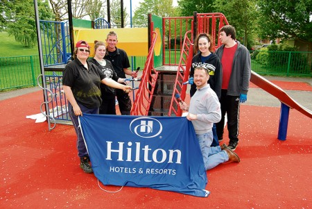 The Hilton Bristol team renovating the Paddock Close playground.