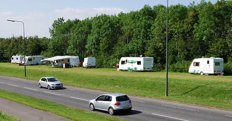 Unauthorised traveller encampment on a verge alongside Bradley Stoke Way.