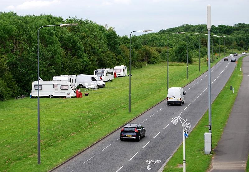 Traveller vehicles park on a verge alongside Bradley Stoke Way.
