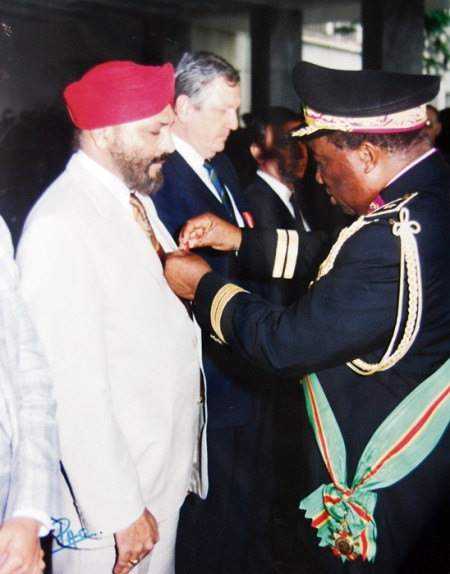Doctor Harmandar Singh Gupta receiving a Zairian knighthood in 1990, for services to foreign embassies.