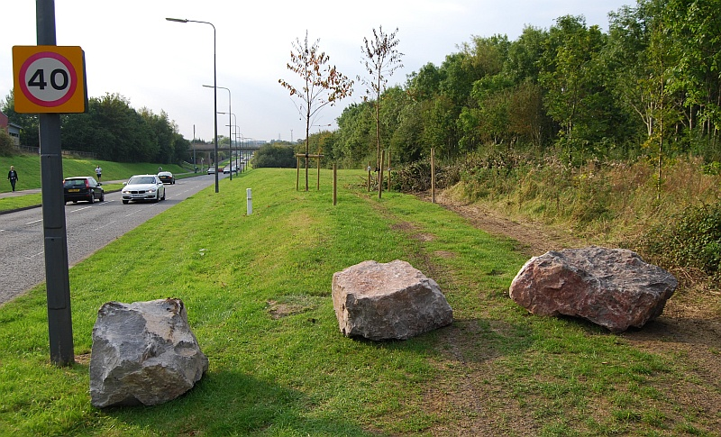 Boulders on a verge alongside Bradley Stoke Way.