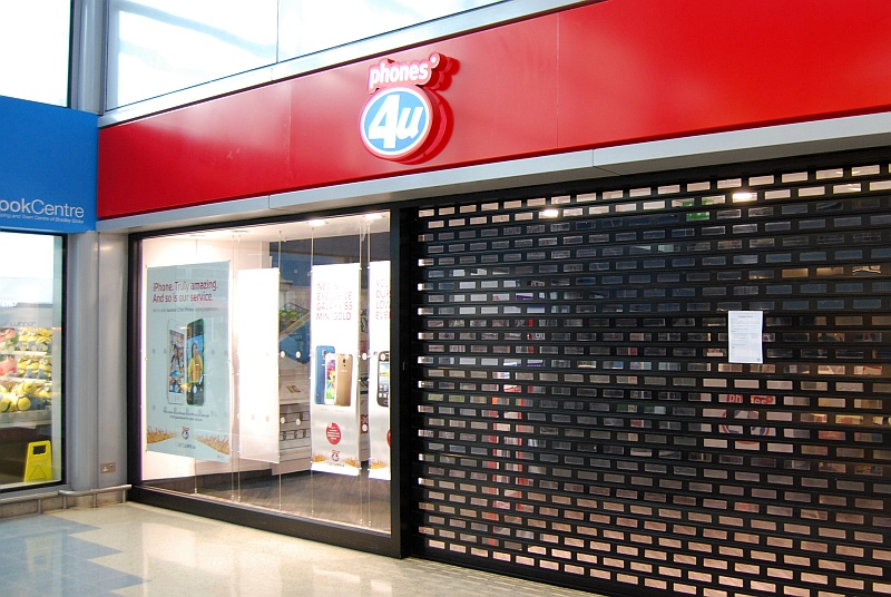 The Phones 4u store at the Willow Brook Centre in Bradley Stoke, Bristol, pictured on 15th September 2014 after it had been announced that the mobile phone retailer had been put into administration.