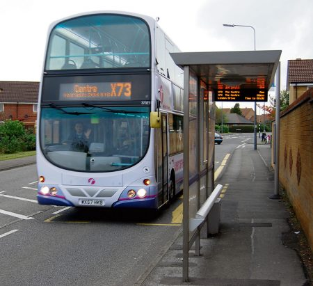 A First West of England X73 bus at the Linden Drive stop in Bradley Stoke, Bristol.
