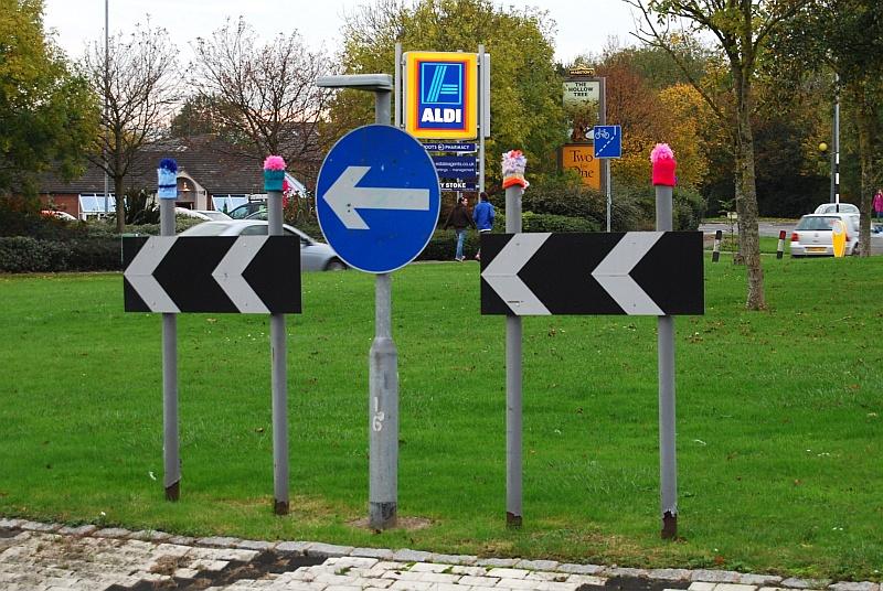 Yarn bombing on Patchway Brook Roundabout in Bradley Stoke, Bristol.