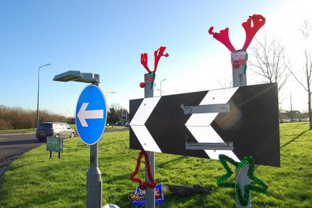 Christmas decorations on a road sign in Bradley Stoke.