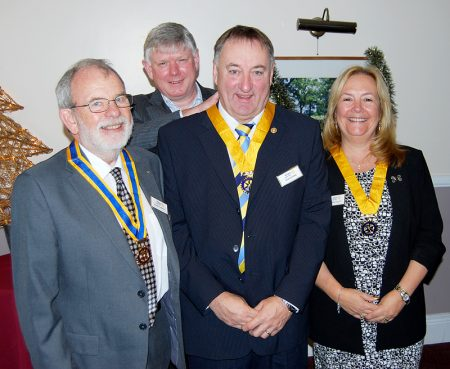 Bradley Stoke Rotary Club president Phil King presents new regalia to (front, l-r): Roger Worth, Bob Warne and Karen Holley.