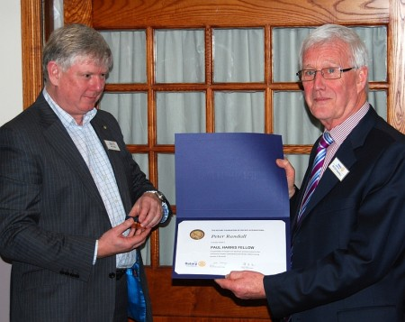 Peter Randall of Bradley Stoke Rotary Club (right) receives the Paul Harris Award from club president Phil King.