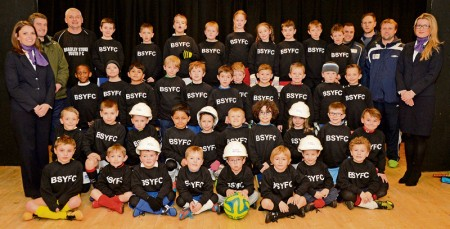 Bradley Stoke Youth FC's U7 players wearing sweatshirts funded by housebuilder Taylor Wimpey.
