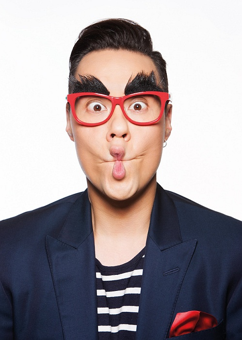 Gok Wan models Specsavers' Red Nose Day comedy glasses.