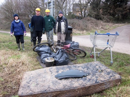 Conservation group members with rubbish cleared from the brook.