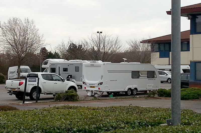Traveller vehicles in the car park of Kerry Group, Great Park Road, Bradley Stoke, Bristol.