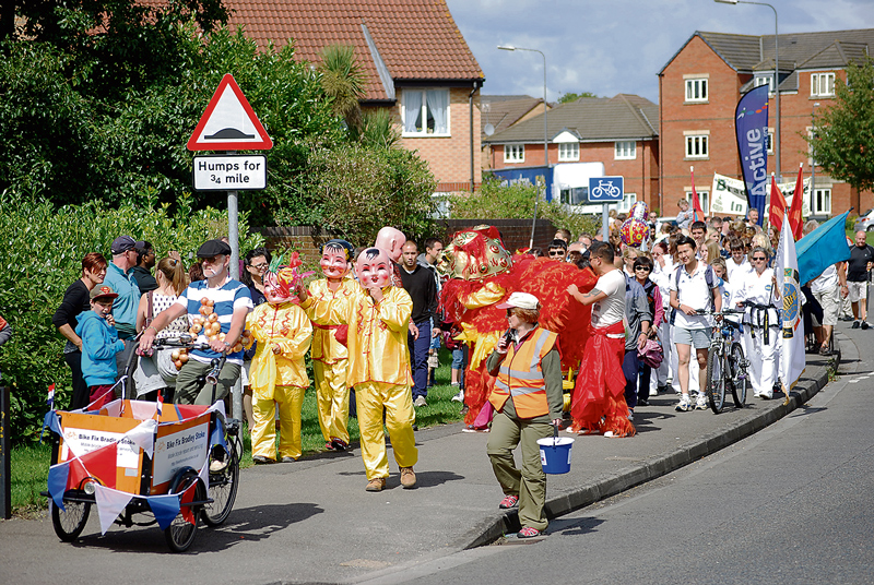 The 2014 Bradley Stoke Carnival parade approaches Manor Farm Roundabout.